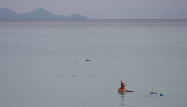 Elderly couple snorkelling off Sunrise beach, Koh Lipe
