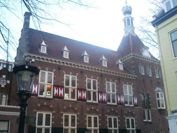 Building with red and white shutters, close to de Dom